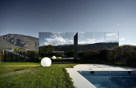 Mirror houses covered with mirrors creates an illusion that the property is almost invisible