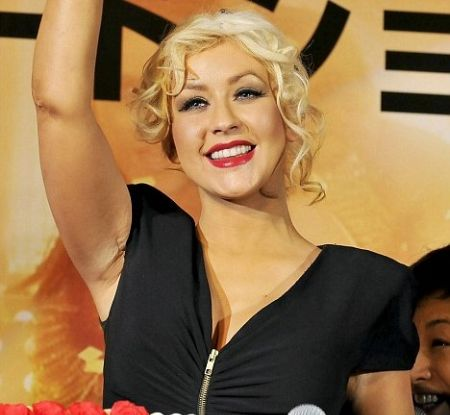 The armpit scar like the one on Christina's armpit is usually indicative of breast augmentation surgery